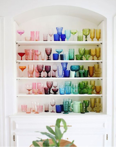Colorful glassware and cookware to brighten open shelf space and bring color into your kitchen space.