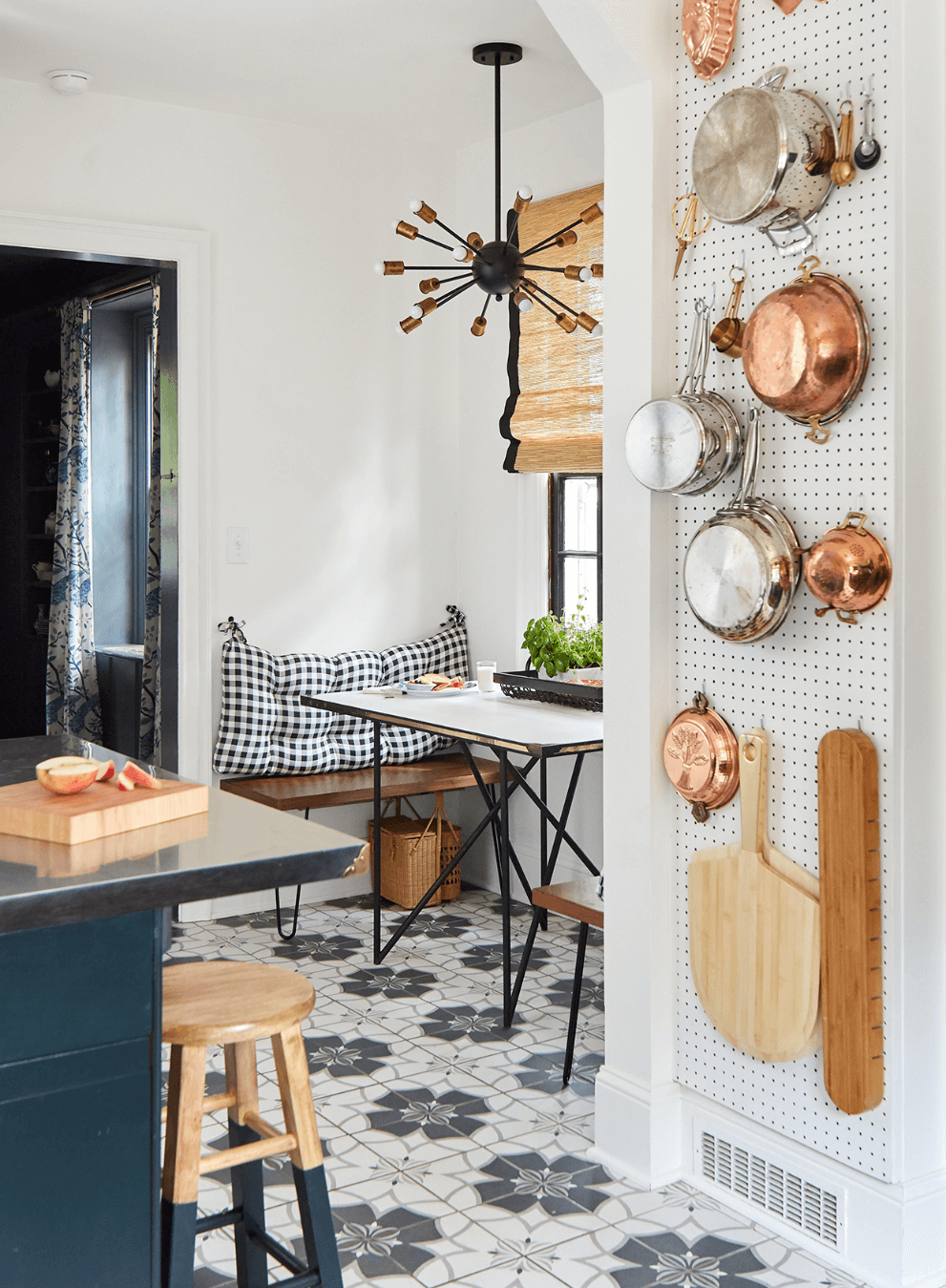Small mid-century modern kitchen with a pegboard wall for a creative way to store your cooking essentials.