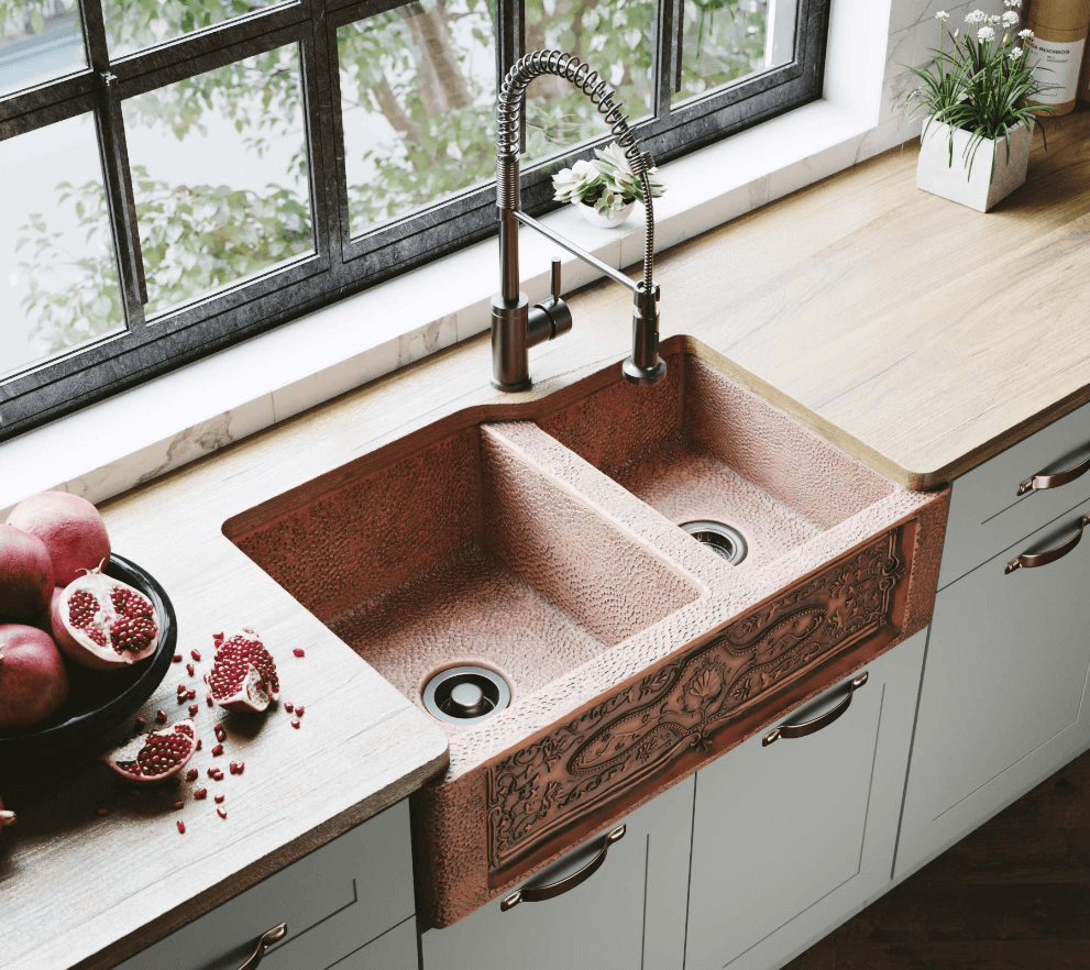 Timeless copper apron sink in a farmhouse kitchen.