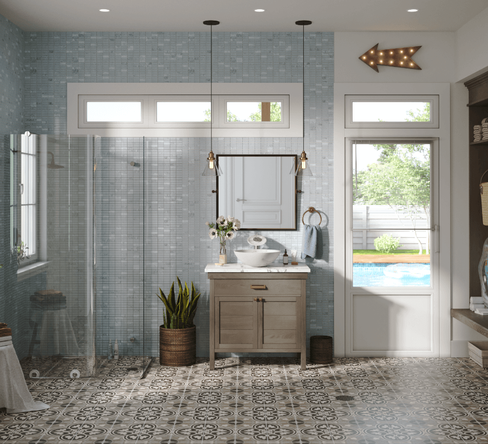 Coastal chic pool house bathroom with bold tile flooring and a modern glass walk-in shower.