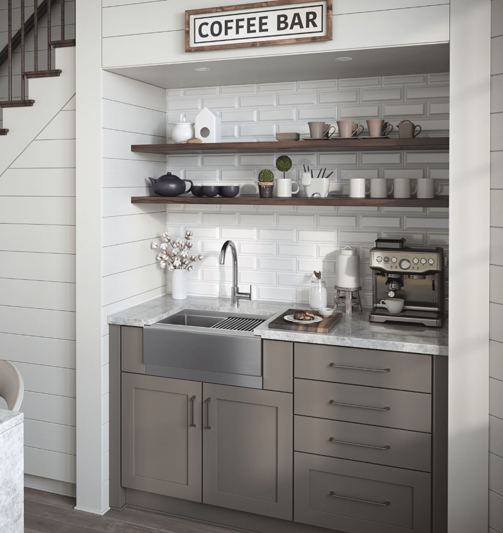 Stainless steel farmhouse sink in a coffee nook with white subway tile as a backsplash.