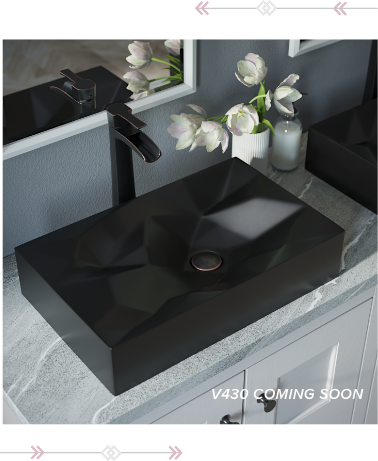 Geometric matte black vessel sink inside of a contemporary bathroom.