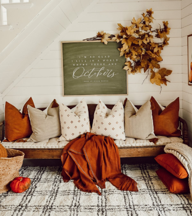 Farmhouse entryway, fall foliage accents, a shiplap accent wall inside of a modern farmhouse home.