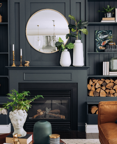 Create a unique and high-class look by making the bold choice of painting your living room wall black!