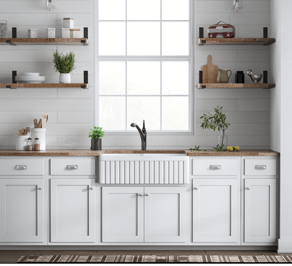 Modern farmhouse kitchen design with white kitchen cabinets, rustic butcher block countertops and apron front farmhouse sink.