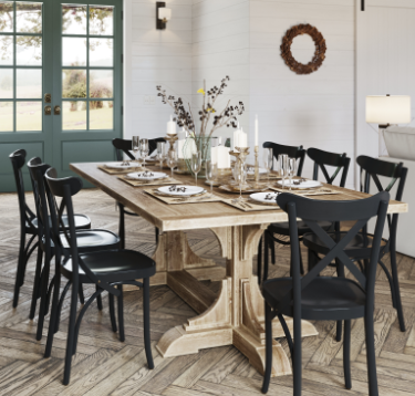 Farmhouse table with natural decor pieces like fall berries and twigs, and neutral colored placemats.