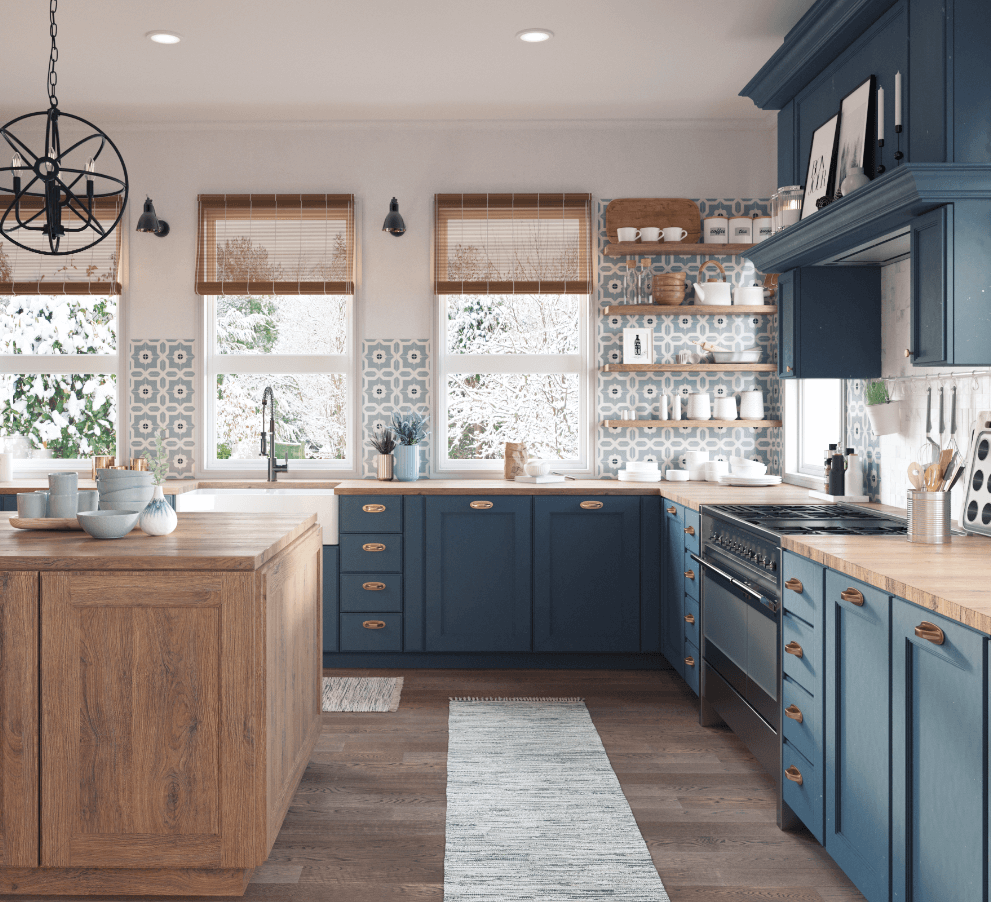 Modern bohemian kitchen design with copper hardware, farmhouse fireclay sink and bold blue cabinetry.