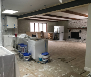 Large home renovation with wall knocked down to create an open floor plan.