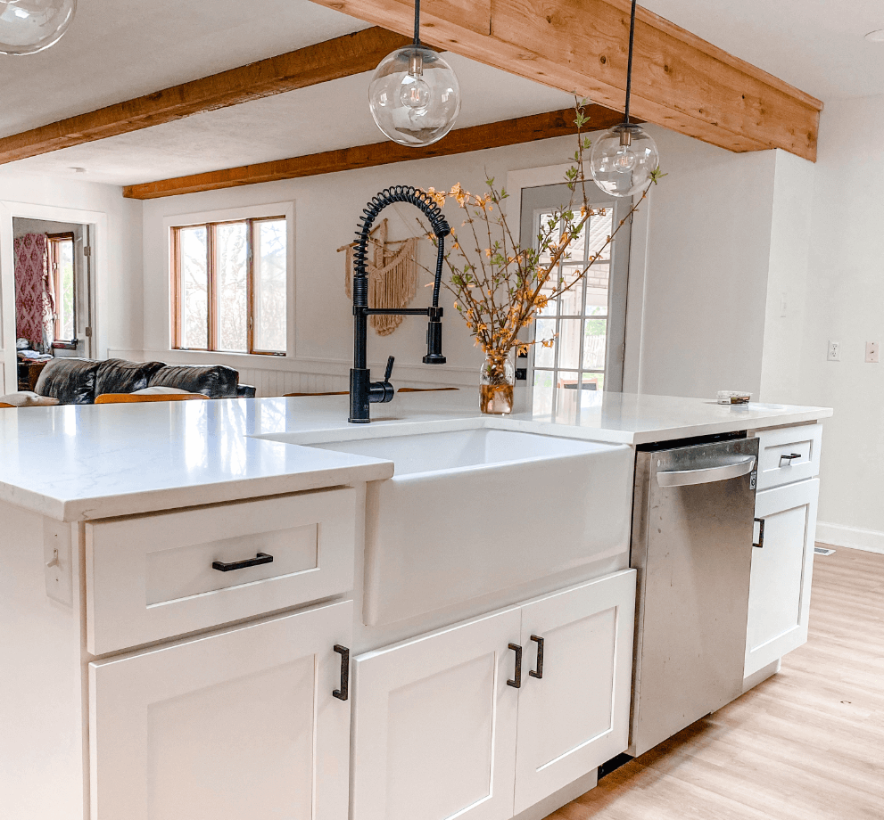 Farmhouse MR Direct apron fireclay sink and antique bronze faucet inside of farmhouse modern kitchen design.