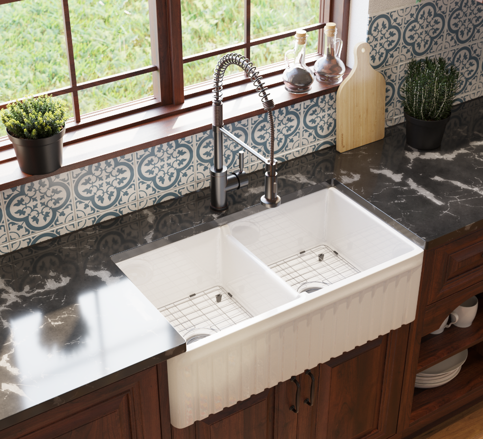 Moroccan kitchen design with double bowl fireclay sink with stainless steel sink grids, painted ceramic tile backsplash with rustic oak cabinetry.