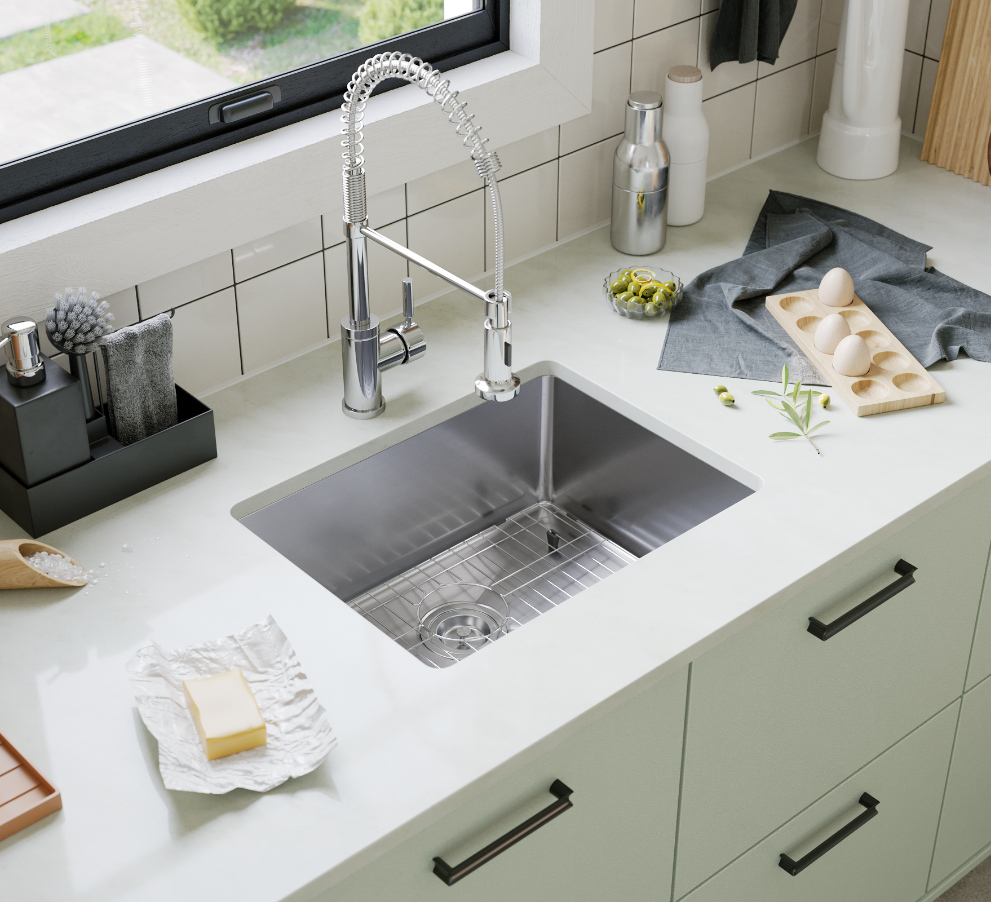 Stainless steel sink with spring-spout faucet and green cabinets with white tile backsplash.
