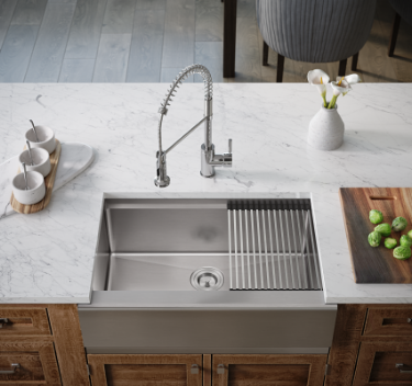 Update your kitchen by installing an apron front, versatile workspace sink.