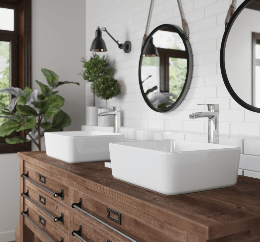Farmhouse bathroom design with oak cabinetry, bright white subway tile walls and porcelain vessel sinks.