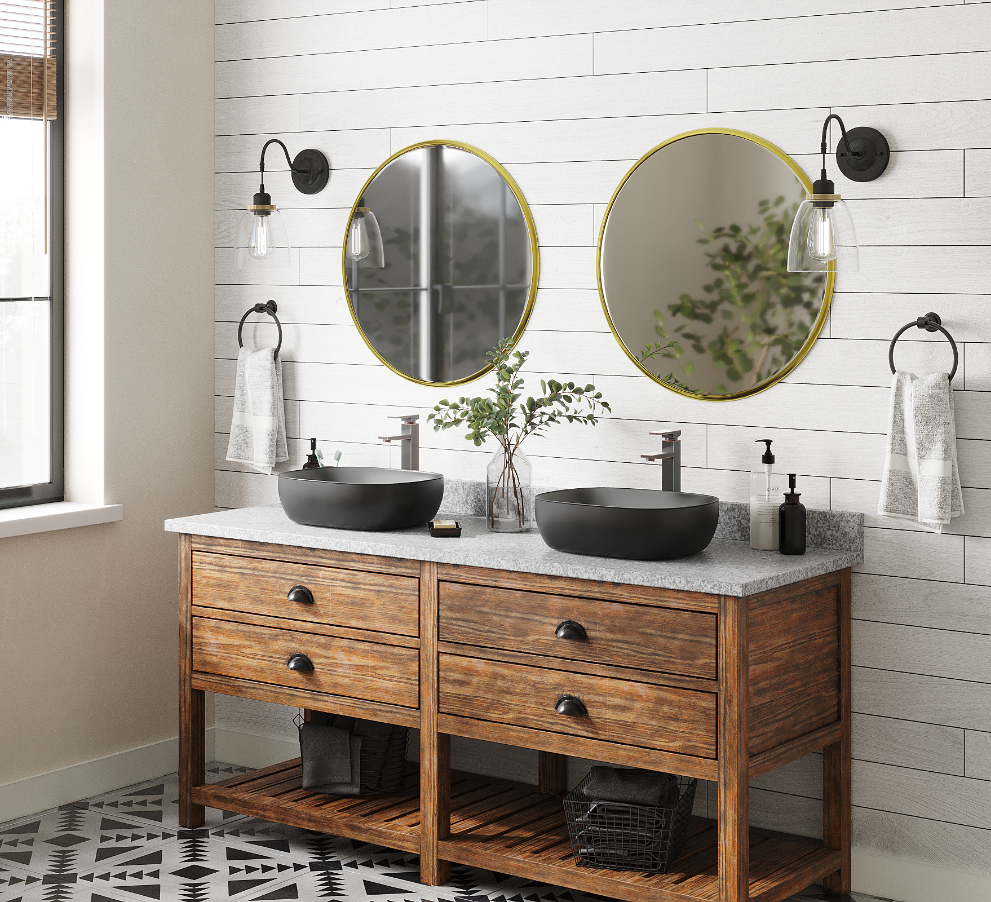 Matte black porcelain bathroom sink with shiplap walls and oak vanity top with gold mirrors.