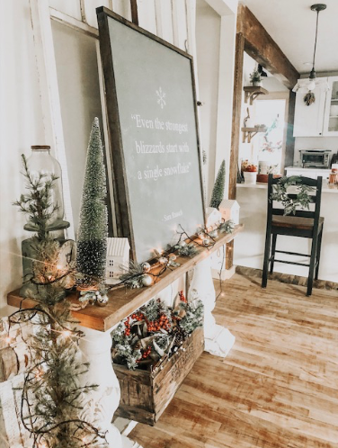 Beautiful farmhouse shelf decorated with Christmas trees and lights!