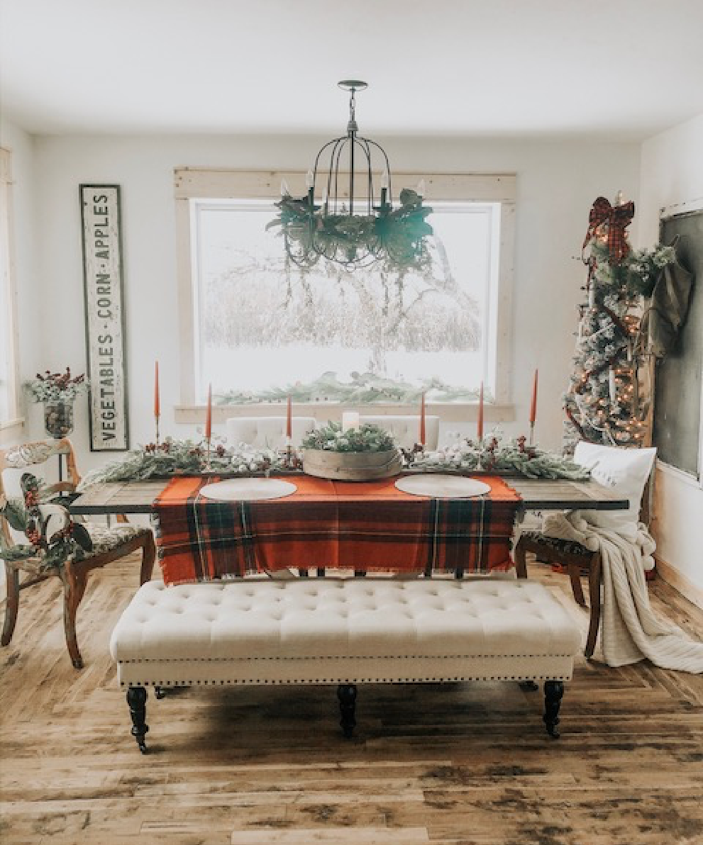 Dining room ready for holiday guests with placemats and Christmas decor.