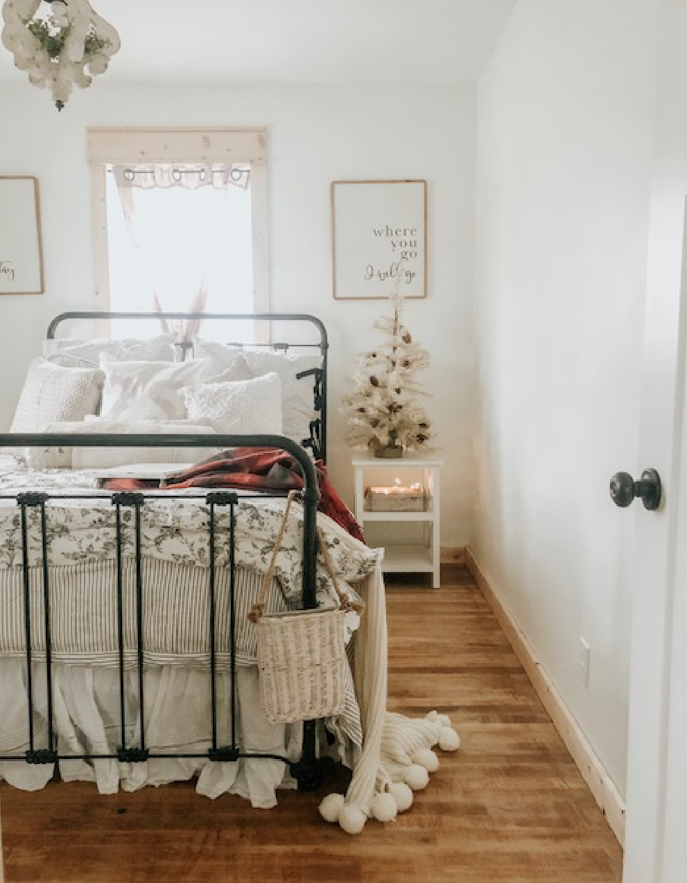 Christmas decorations and treasured pieces inside of cozy little guest bedroom.