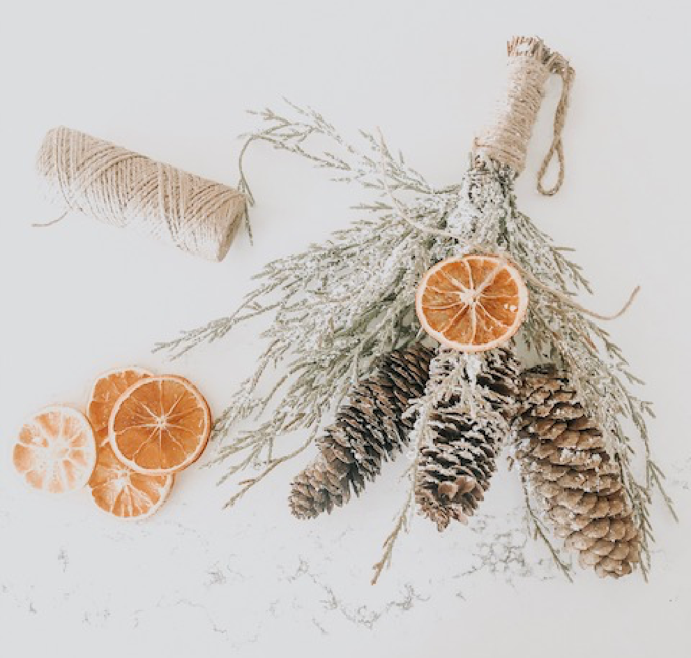 Make your own decorations by gathering some branches, pine, and dried oranges!