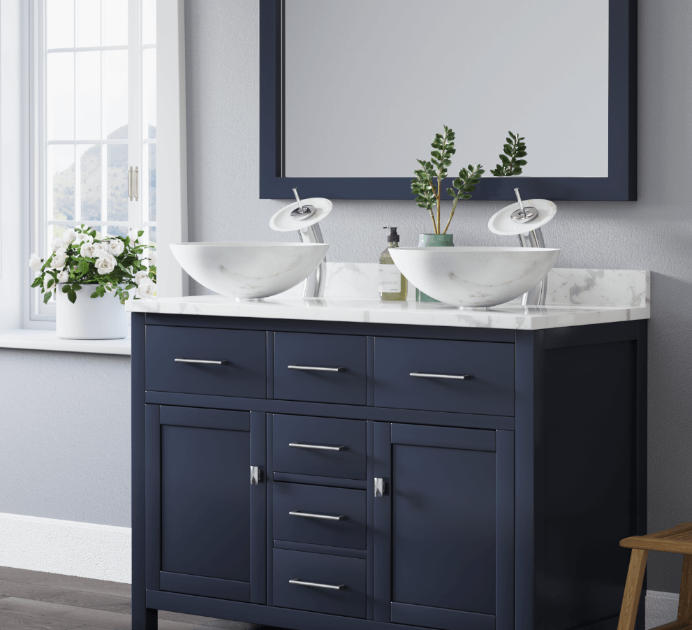White granite vessel sink inside of a large bathroom with navy blue cabinetry, and soft gray walls.