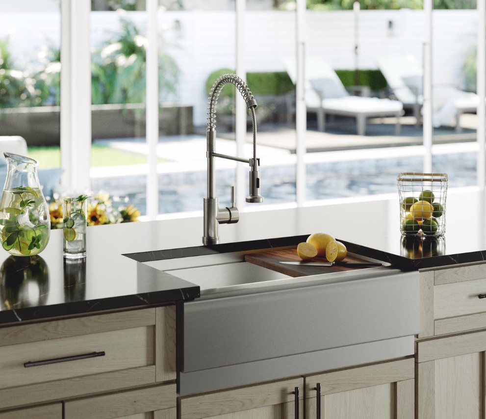 Modern kitchen design with farmhouse apron stainless sink and fresh citrus.
