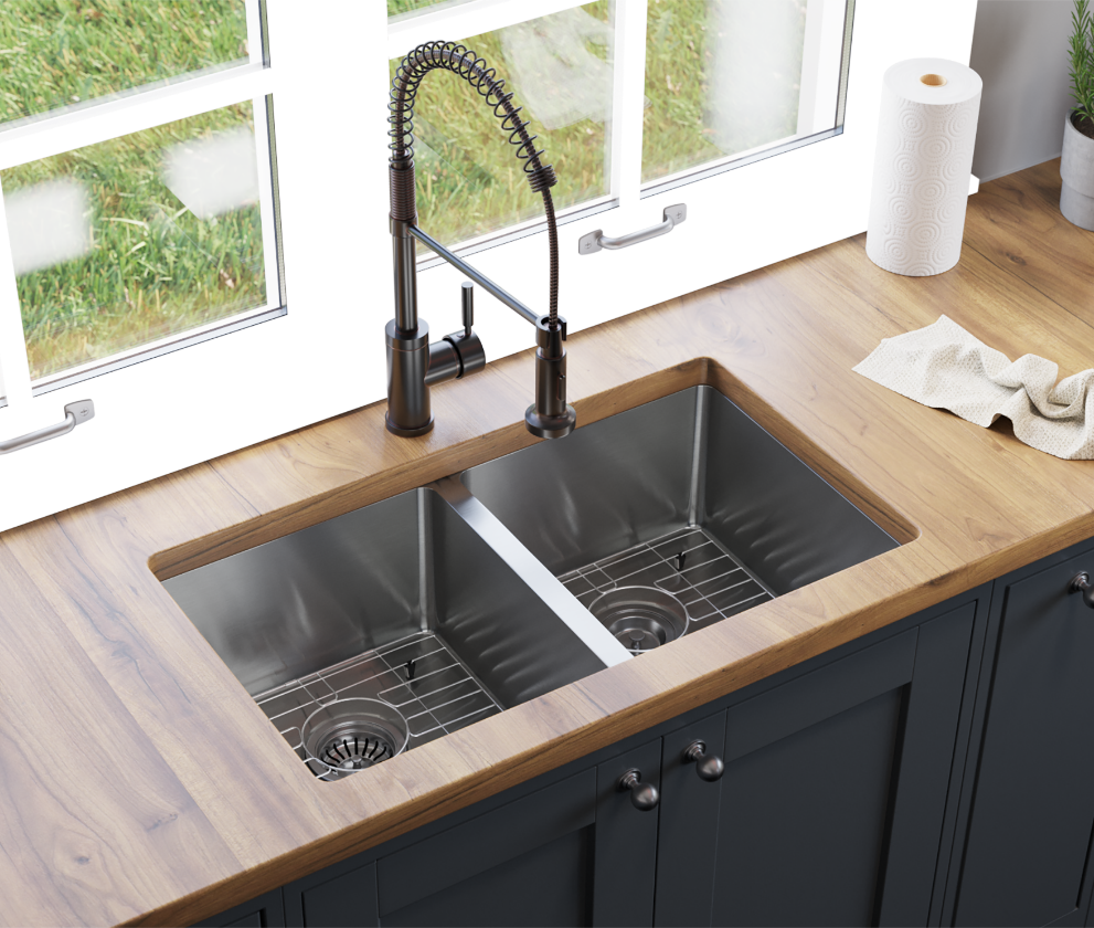 Stainless steel sink with antique bronze faucet with butcher block countertops inside of a modern kitchen design.