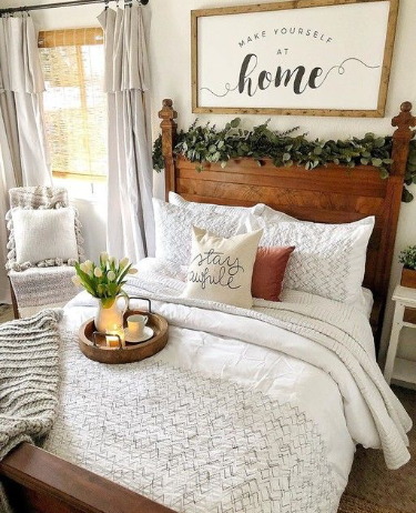 Cozy up the guest bedroom with fresh linens and a seasonal candle.