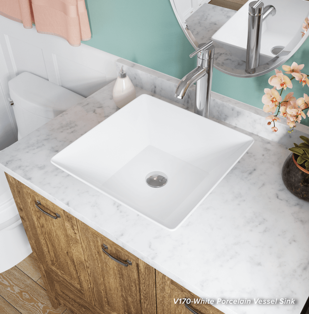 Add a minimalistic touch by adding a classic white porcelain sink inside of your traditional bathroom.