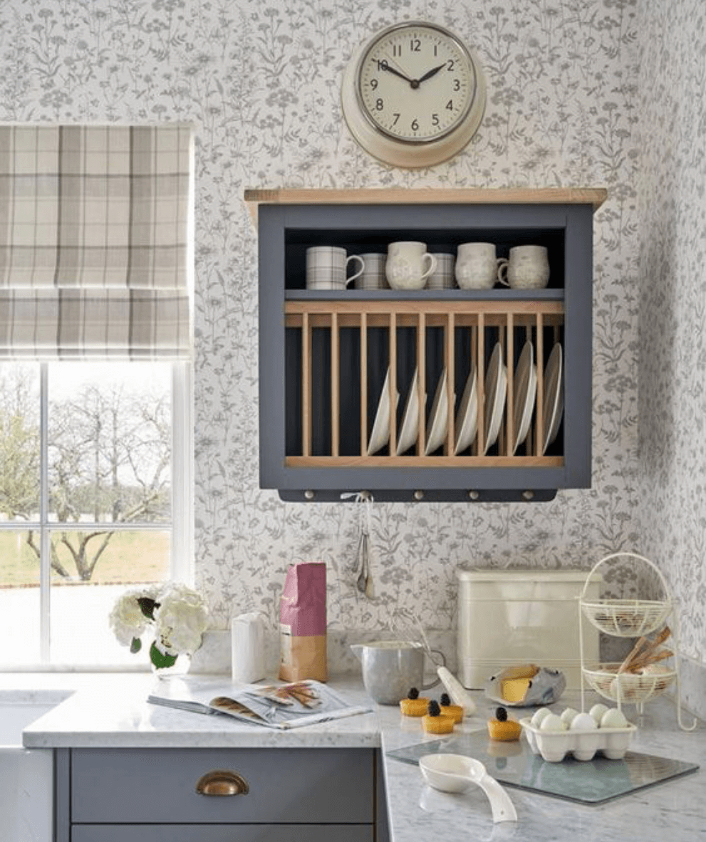 Save space in your busy kitchen by adding a plate rack above the kitchen sink. class=