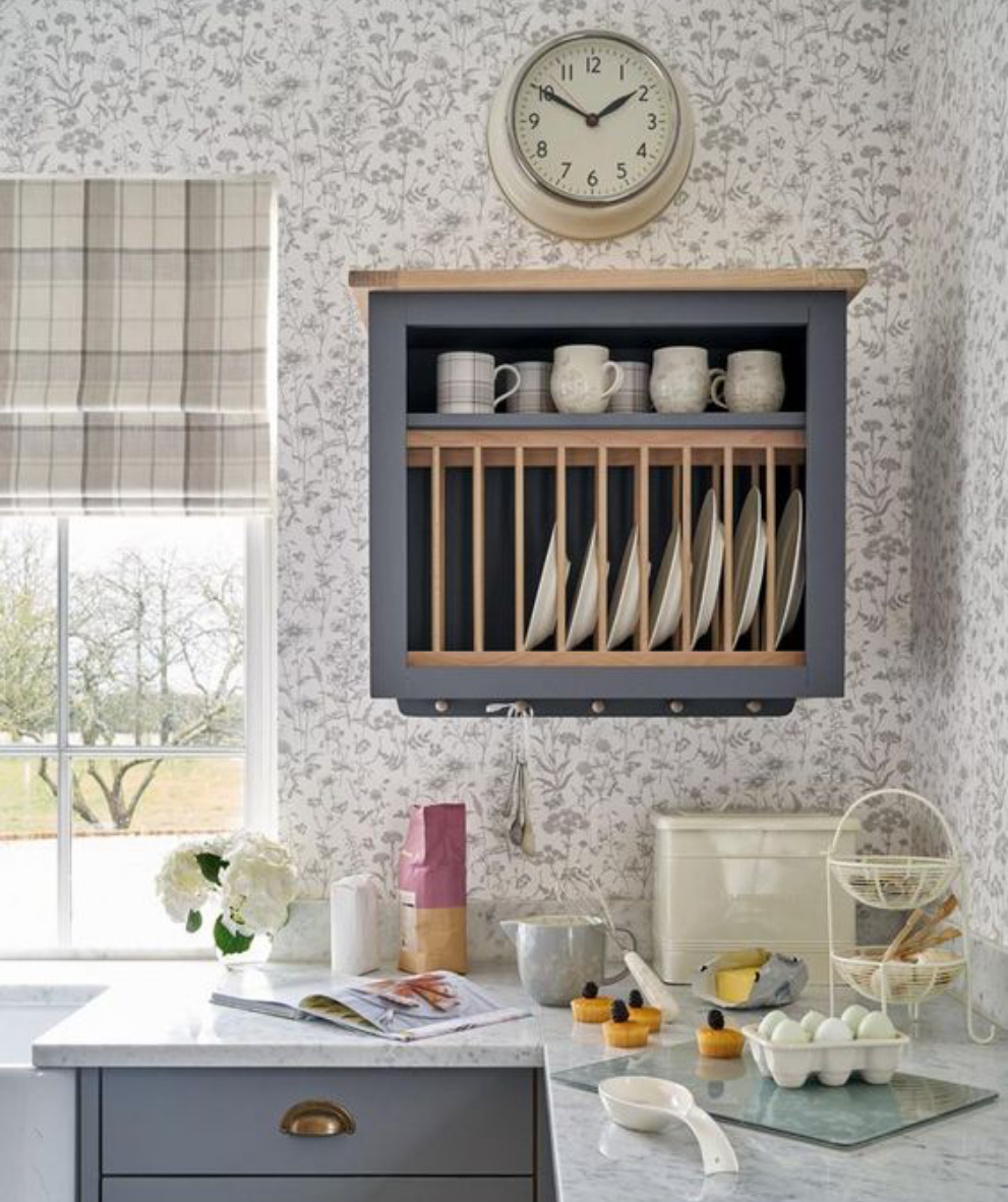 Save space in your busy kitchen by adding a plate rack above the kitchen sink.