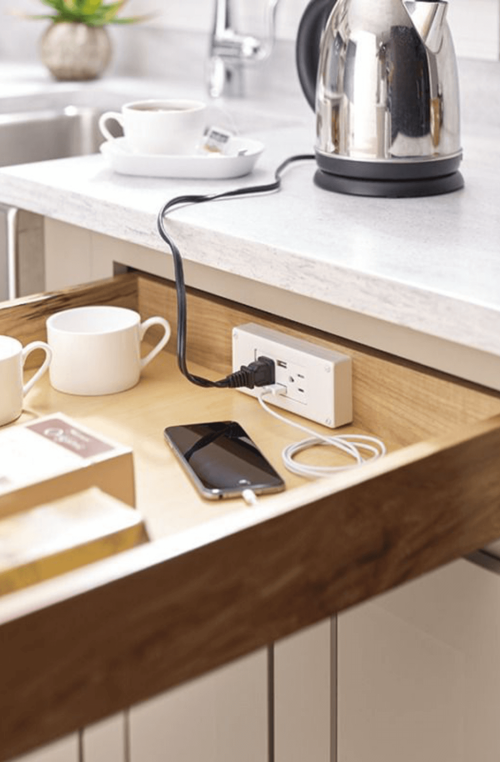 Smart kitchen with power outlets and USB ports built right into the cabinet.