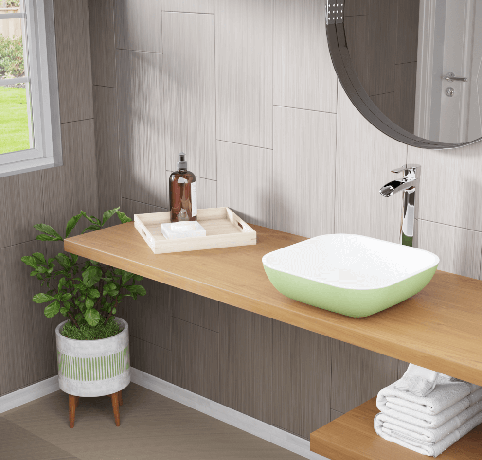 Spacious and minimalistic bathroom with sage green polystone (composite) bathroom sink and greenery that brightens up the space.