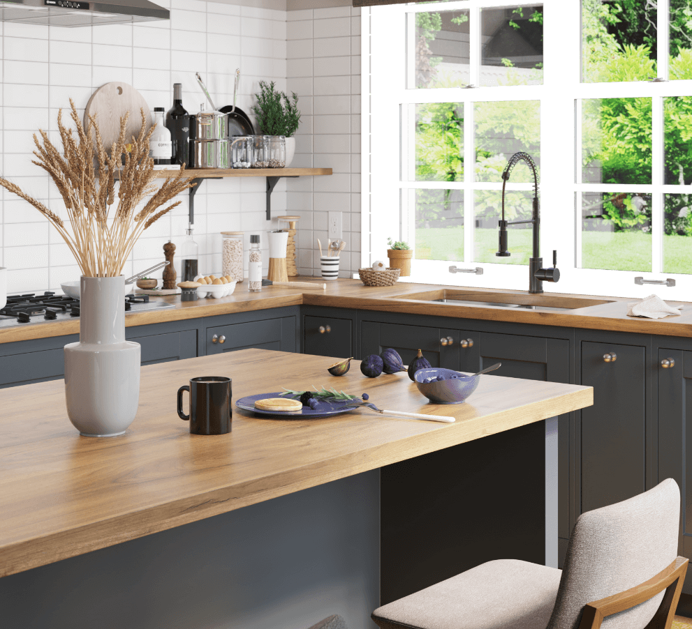 Stainless steel kitchen sink inside of a modern bohemian kitchen with large windows for plenty of natural light and open shelving.