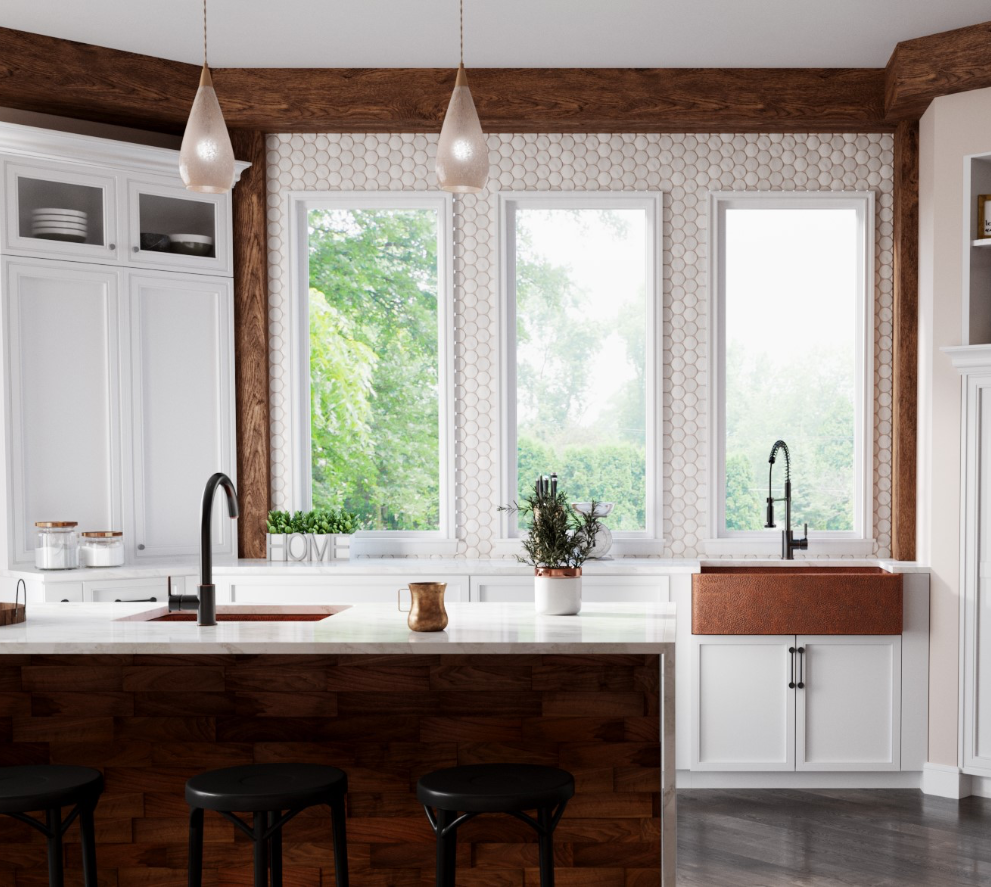 Farmhouse Apron copper sink and copper bar sink with bar faucet inside of a traditional kitchen with a white tile backsplash, white cabinetry, and matte black accents.