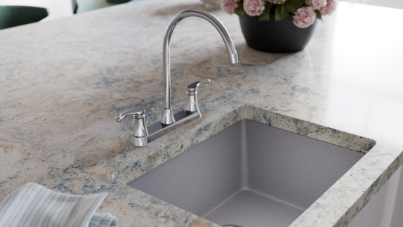 Long curved faucet on a granite countertop