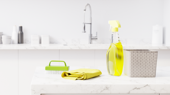 Cleaning supplies on a white granite countertop