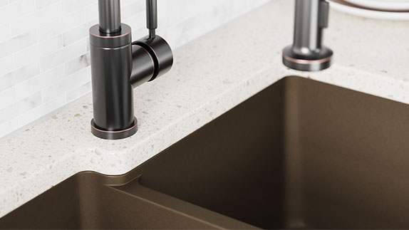 Undermount TruGranite sinks sit below the countertop