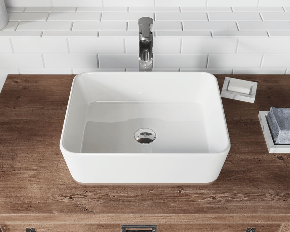 V140-Bisque Lifestyle Image: Vitreous China Rectangle Vessel Bisque Bathroom Sink